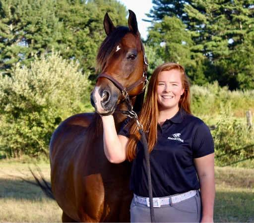 SmartPak customer care representative with her bay Morgan Horse.